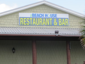 Beach House front sign -- 1154 West Beach Boulevard in Gulf Shores, AL.