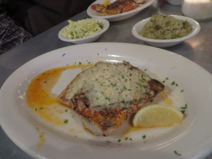 Grilled mahi mahi topped with crabmeat and cheese.