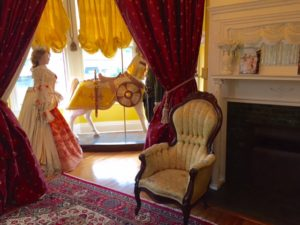 Fireplace and carved carousel horse in Camelot room.
