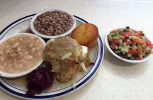 Chicken and dressing, black-eyed peas, Great Northern beans, tomato/cucumber salad, cornbread.