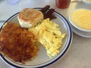 Scrambled eggs, bacon, fluffy biscuit, hashbrowns and cheese grits.