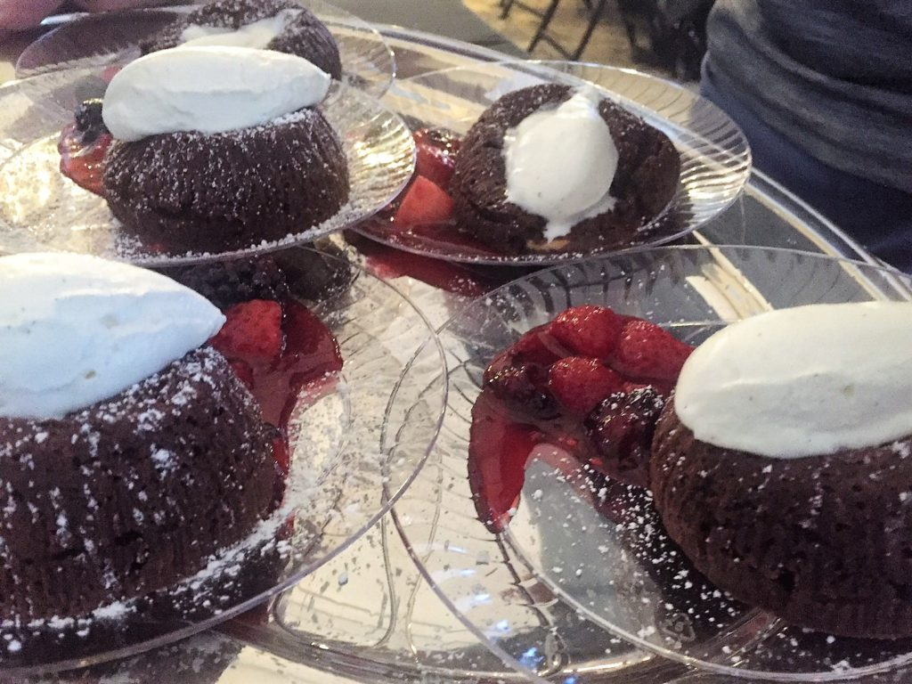 Chocolate lava cake with whipped cream and berries.