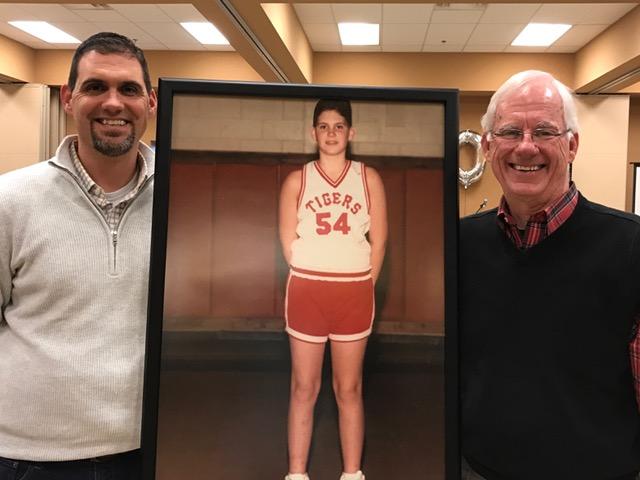 Matt and his dad posing by Junior High School Matt.