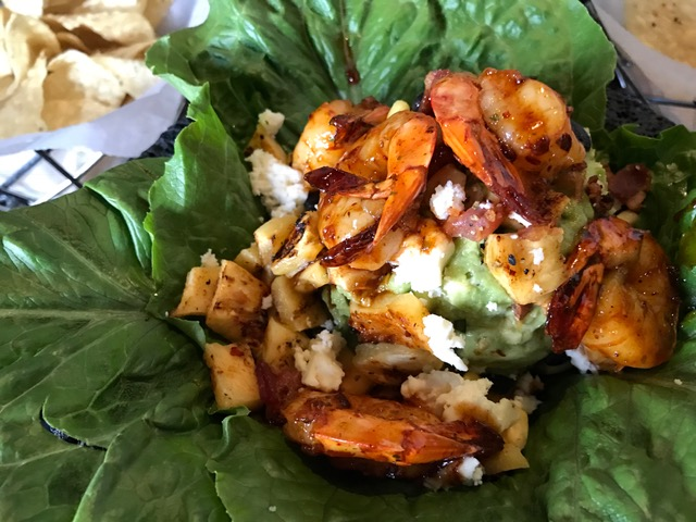 Guacamole with grilled pineapple and shrimp.
